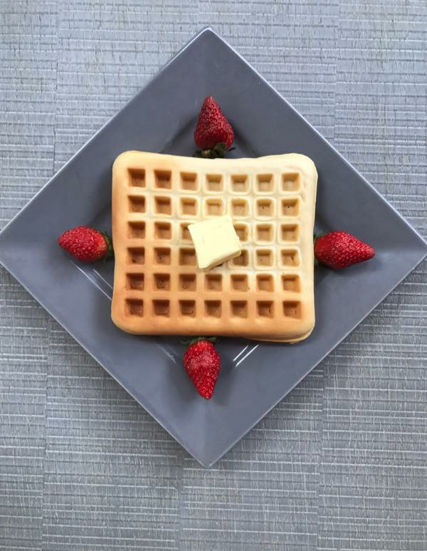 american waffle with mapple syrup and butter